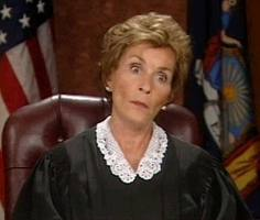 judge judy sitting on the bench in her court room