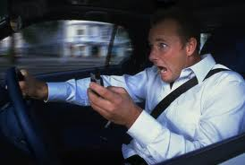 man in car texting while driving about to have an accident