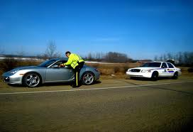 Officer issueing a speeding ticket to a Florida driver