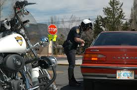 motorcycle policeman giving a traffic ticket