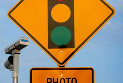 "Red light camera ""Photo Enforced"" traffic sign"