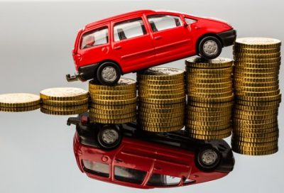 toy car climbing over coins