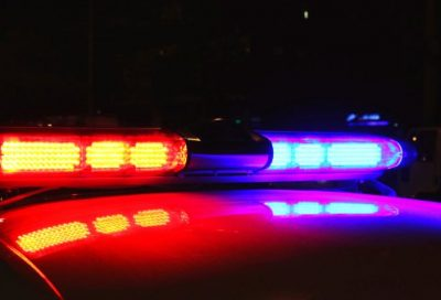 police car at night with red and blue lights on